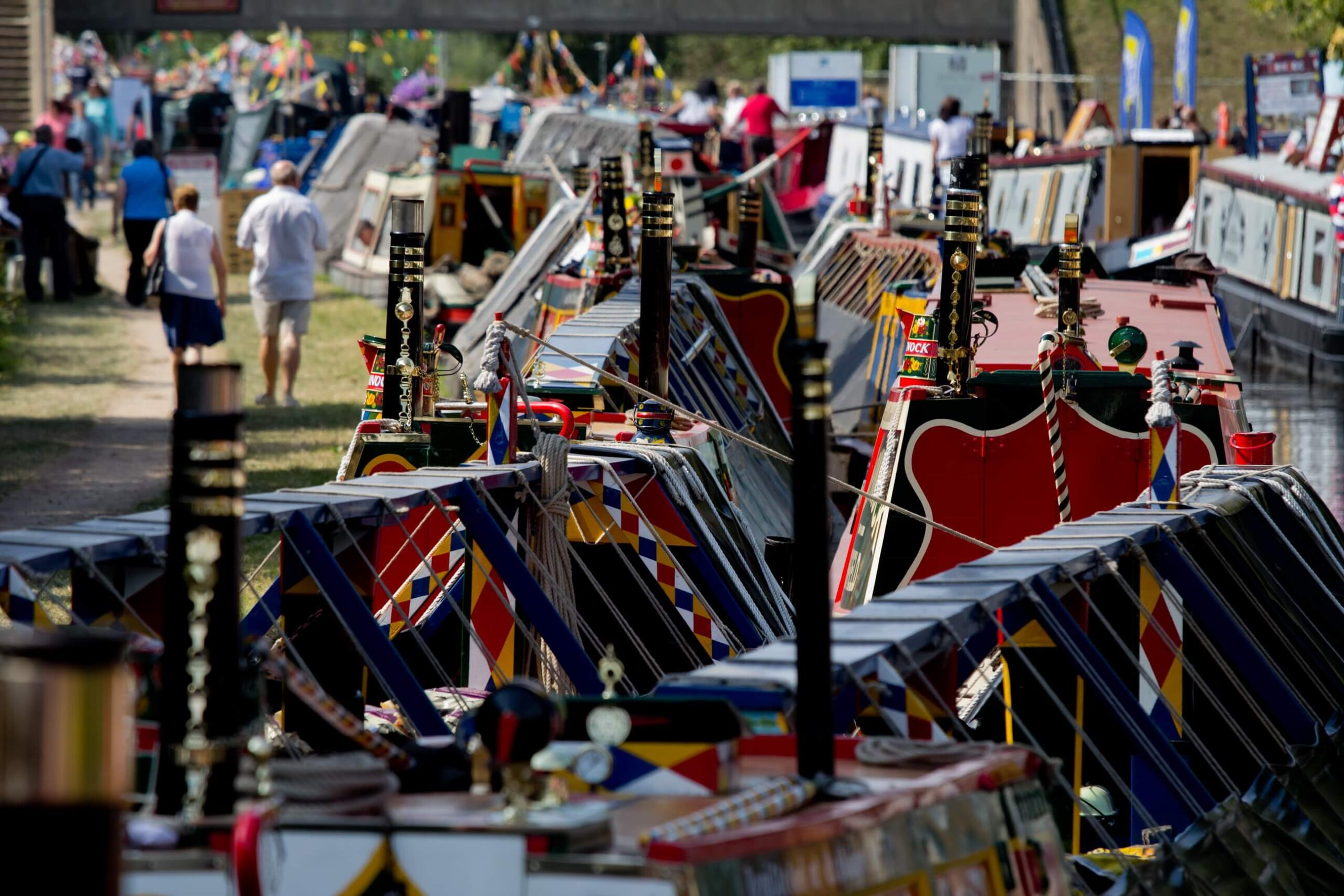 Flag festooned canal boats at The Waterways Festival
