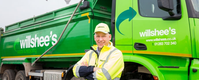 Gary Frost standing in front of recycling lorry