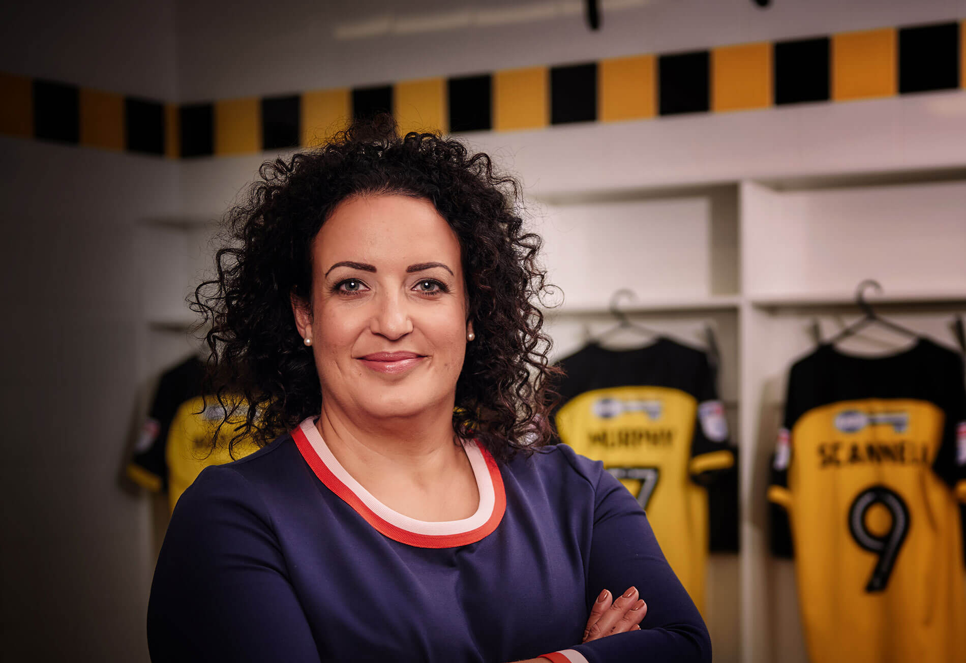 Profile photo of Fleur Robinson inside the changing rooms of Burton Albion FC