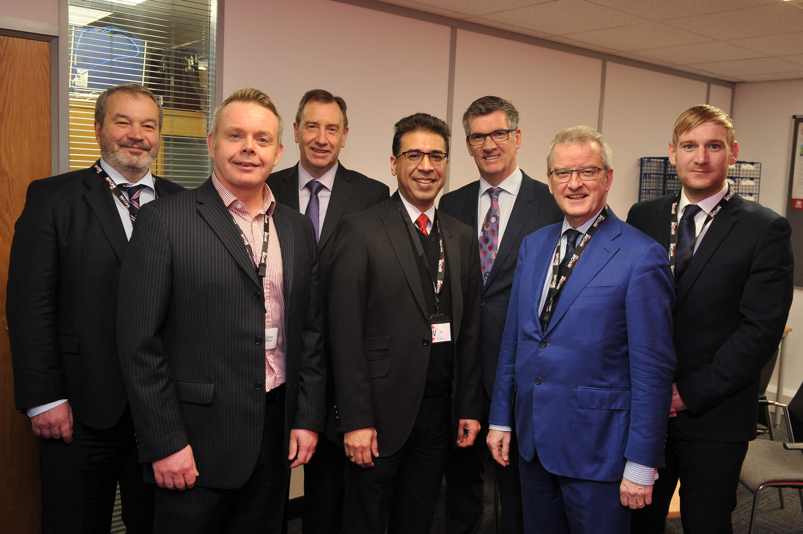 Seven men representing Malone Group, Burton Albion FC and the Burton & District Chamber of Commerce at the official opening their UK HQ in Burton