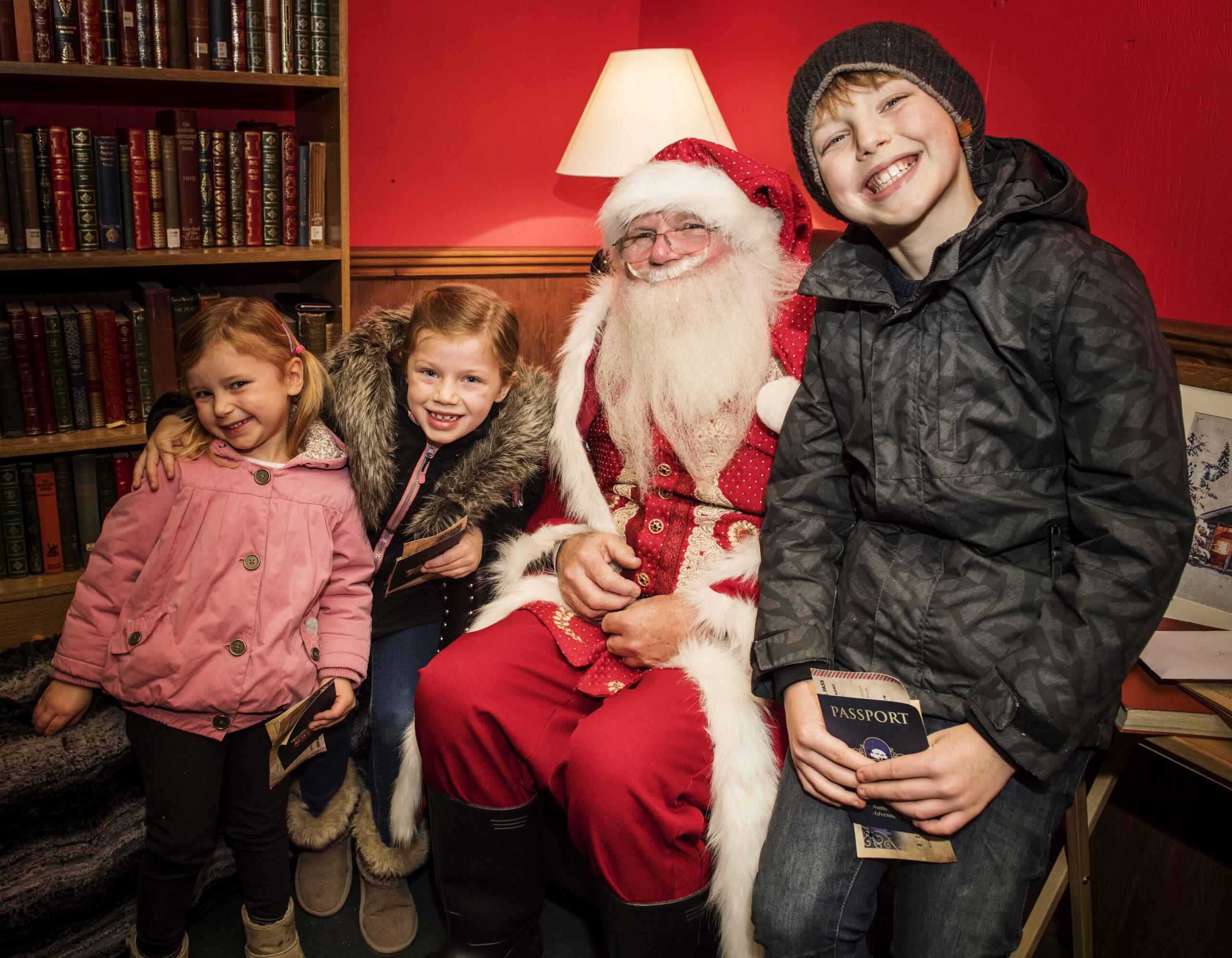 Three children meeting Father Christmas