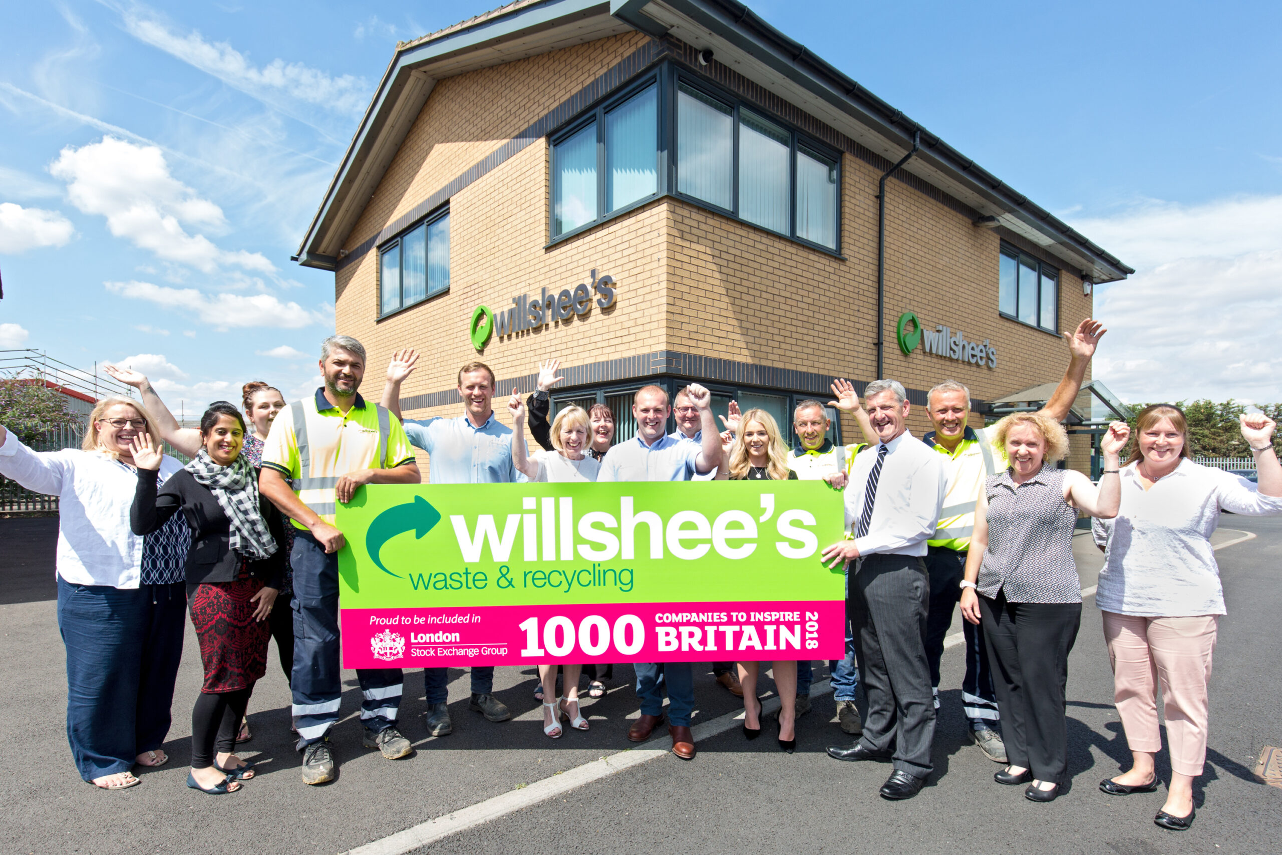 Fifteen people representing Willshee's outside their Burton HQ office